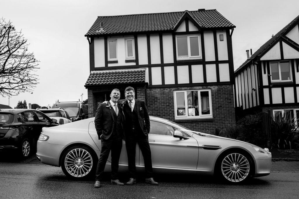 Groom and son with Aston Martin - Whiston Manorial Barn Wedding Photography,Rotherham  wedding photographer