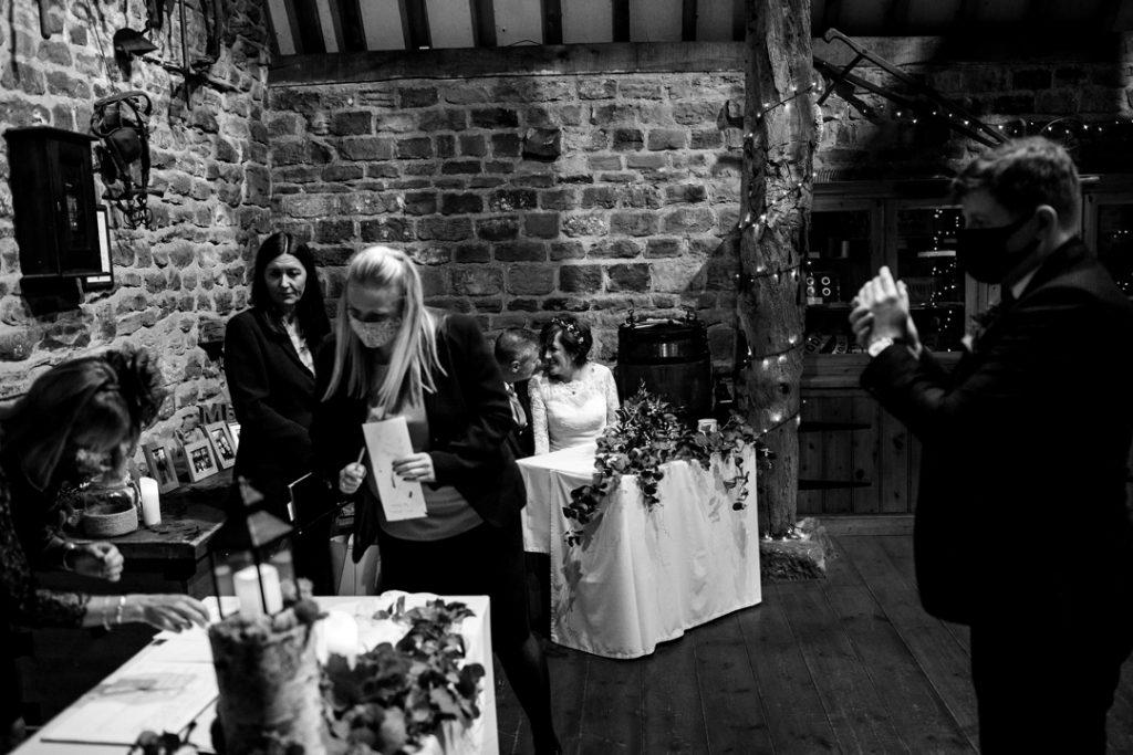 signing of register - Whiston Manorial Barn Wedding Photography,Rotherham  wedding photographer