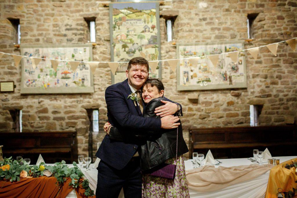 hugging guests - Whiston Manorial Barn Wedding Photography,Rotherham  wedding photographer