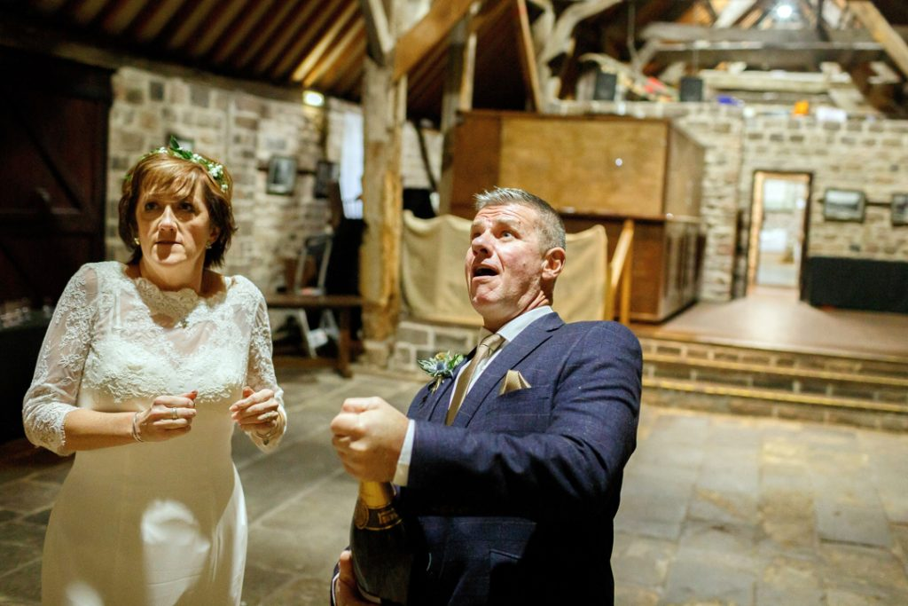 Groom popping cork - Whiston Manorial Barn Wedding Photography,Rotherham  wedding photographer