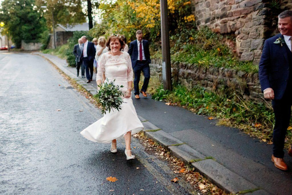 Bride and groom walking - Whiston Manorial Barn Wedding Photography,Rotherham  wedding photographer