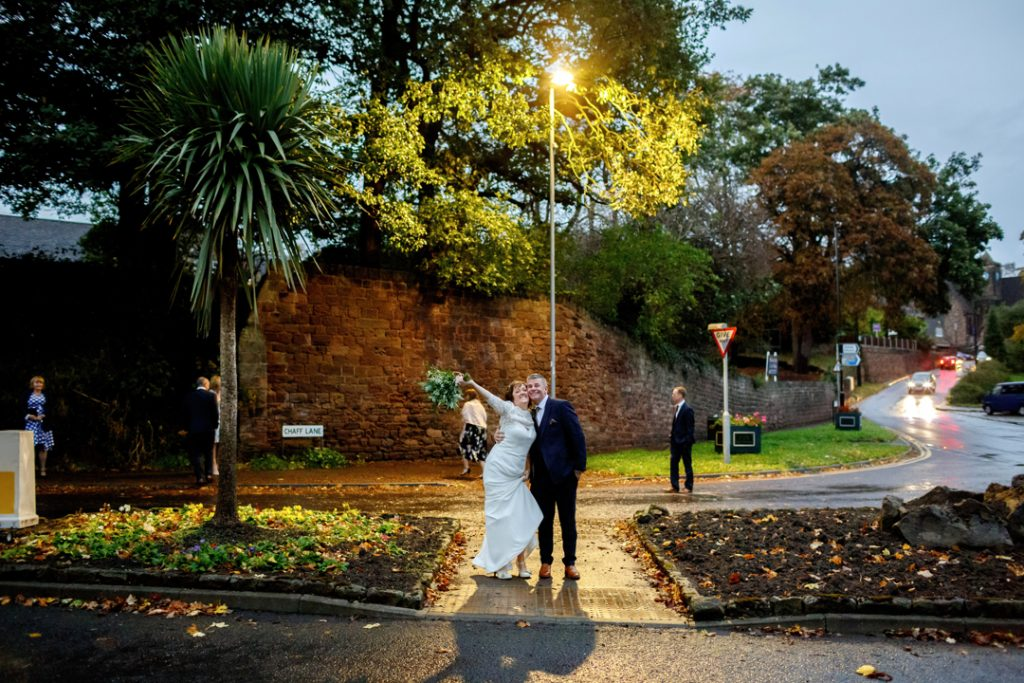 Whiston Manorial Barn Wedding Photography,Rotherham  bride and groom posing in the middle of the road