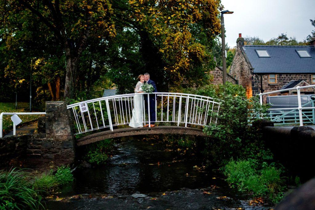 Bride and groom on bridge - Whiston Manorial Barn Wedding Photography,Rotherham  wedding photographer