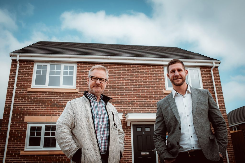 Paul Norton and Mike from property standing next to a house